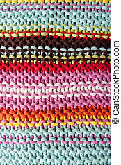 macro knitted texture background - close up of a striped...