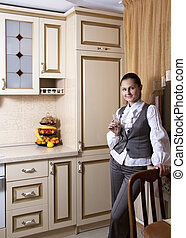 Young woman to kitchen in classical style