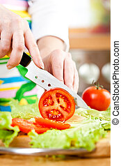 Woman's hands cutting vegetables - Woman's hands cutting...