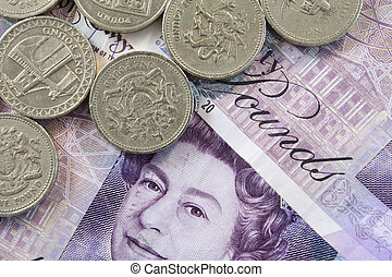UK Money - Close up of pound coins on a background of 20...