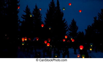 Candle lantern floating up into the air - rice paper hot air...