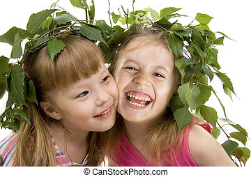 Two cheerful little girls of the friend on a white...