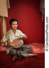 Indian Man Plays a Tabla - Young Handsome Indian man plays a...