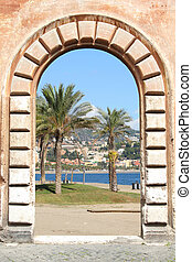 Malaga, Spain - Vintage door view - palm trees and beach in...