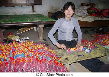 Woman packing the incense sticks - Woman packing the sticks...
