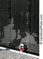 Historic Vietnam Wall - A memorial wreath at the base of the...