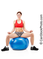 woman exercising on an exercise ball