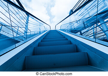 walkway - moving walkway to the blue sky and cloud of a city...