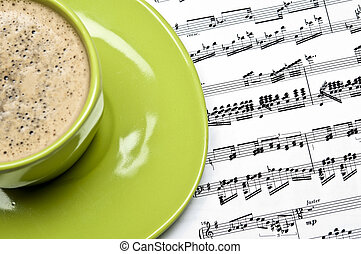 Coffee and musical score closeup