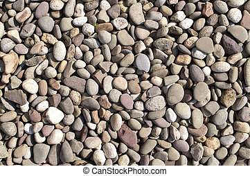 River Stones - Rover stones of different colors laid out on...