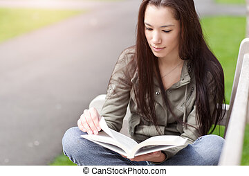 Ethnic college student studying - A shot of an ethnic...