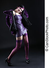 Young girl in purple fur coat and gothic make-up