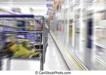Grocery shopping cart - partial view from behind of a...