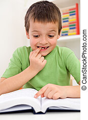 School boy with reading problems - Stressed elementary...