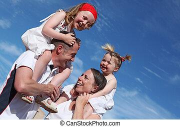 happy healthy family outdoors