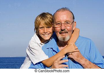 child hugging grandfather