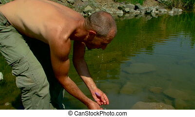 Man washes - A man washes a wild river.