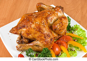 roasted chicken garnished with fresh tomatoes, green salad,...
