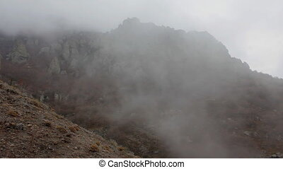Time lapse of foggy mountain landscape