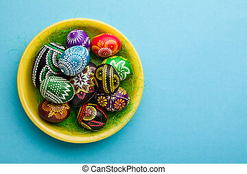 Easter decoration - painted Easter eggs on yellow plate