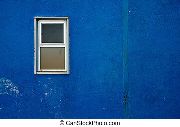 Small window on Blue Wall - A small window on a blue, rough...