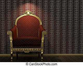 Golden and red armchair under spot light