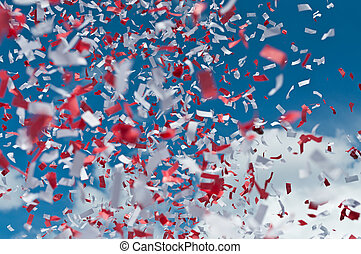 Red and White Confetti in the Air - Red and white strips of...