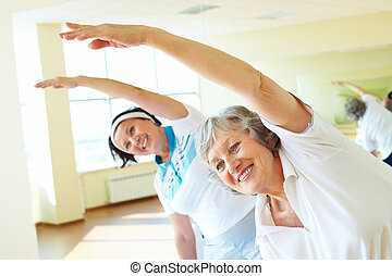 Workout - Portrait of sporty females doing physical exercise...