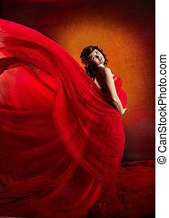 Pregnant woman in red flying waving dress - Pregnant woman...