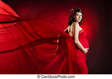 Pregnant woman in red waving dress - Pregnant woman in red...