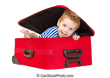 Kid in sailor suit  looking out suitcase