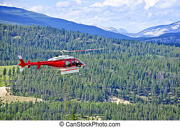 Rescue helicopter in mountains