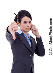 thumb down at phone - business woman with thumb down gesture...