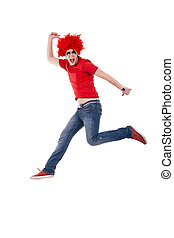 man with red wig screaming and jumping