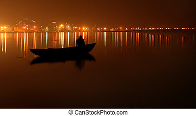 Night on the river Ganges, a landscape, a city of Varanasi,...