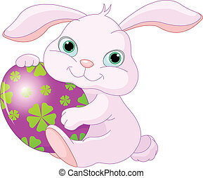 Easter Rabbit holds egg - Small lovely Easter rabbit holds...