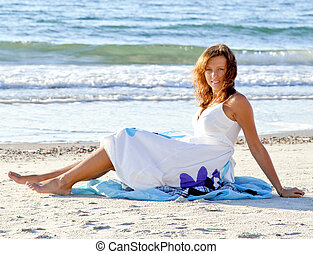 Young girl in sundress on the beach Outdoor shot