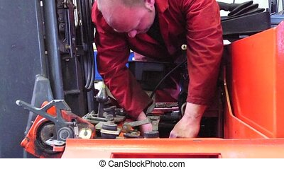 Mechanic at work - Mechanic, working on the engine of a...