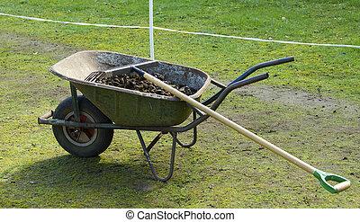 Wheelbarrow with manure - Wheelbarrow in the meadow with...