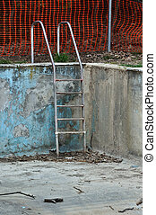 drained swimming pool - Drained swimming pool in abandoned...