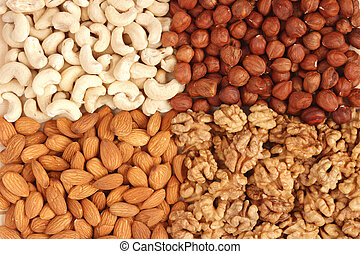 Different nuts (almons, cashews, walnuts and filbers) close...