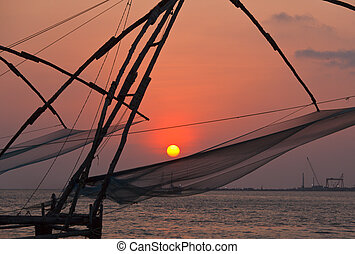 Kochi chinese fishnets on sunset. Fort Kochin, Kochi,...