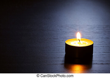 Single candle with back lit. Tranquil scene. - Single candle...