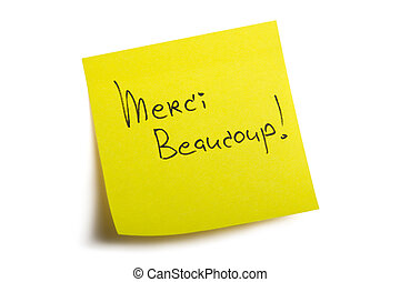Merci Beaucoup! Sticky note. Isolated on white background...