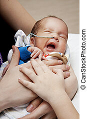 family bond - little premature boy with his family