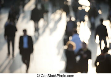 Crowd in sunlight with person on businessman - Blur image of...
