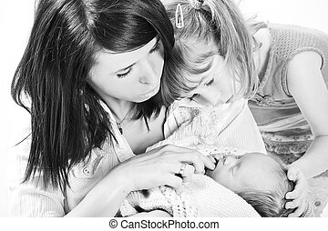family in black and white - mum, her daughter and baby boy...