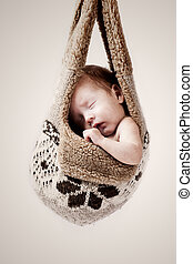hot winter - little baby hanging in the winter hat