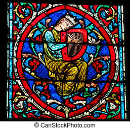 Ancient Music - Harp player - Stained glass window in the...