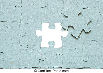 Grey puzzle with missing piece